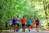 Young people are jogging in the national park, Wollin, Baltic Sea coast, Poland