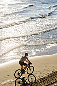 Free-riding cyclist on the beach, Heringsdorf, Usedom, Ostseeküste, Mecklenburg-Vorpommern, Germany