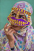 Bandari woman with traditional mask, Persian Gulf, Iran, Asia