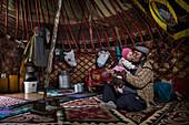 Kyrgyz family in yurt, Kyrgyzstan, Asia