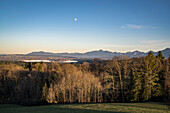 Moon over Staffelsee with view over the bavarian foothills of the Alps, Bad Kohlgrub, Upper Bavaria, Germany