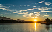 Sunset at Staffelsee with Stand Up Paddler and sailboat, Seehausen, Upper Bavaria, Germany