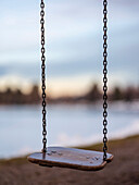 A swing at the Soier See at dusk, Bad Bayersoien, Upper Bavaria, Germany