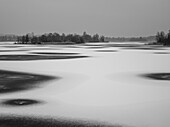 View of the frozen Staffelsee and the island of Buchau in the direction of Uffing, Seehausen, Upper Bavaria, Germany