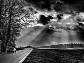 A Ford Capri crosses an atmospheric landscape in Chiemgau, Gstadt am Chiemsee, Upper Bavaria, Germany