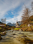 View of Ertlsteg and the parish church of St. Sebastian on the Ramsauer Ache, in the background the Reiter Alm, Ramsau, Upper Bavaria, Germany