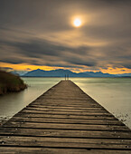 Autumn storm on Lake Chiemsee with view over the jetty to the Chiemgau Alps and Kaisergebirge, Chieming, Upper Bavaria, Germany