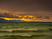 Evening mood on the churned Chiemsee with views of the Chiemgau Alps, Chieming, Upper Bavaria, Germany