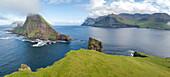 Panoramic of Drangarnir and Tindholmur islet, Vagar Island, Faroe Islands, Denmark, Europe (Drone)