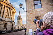 Photographer photographing St. Mary's Church and The Radcliffe Camera in Radcliffe Square, Oxford, Oxfordshire, England, United Kingdom, Europe
