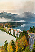 Sylvenstein Lake and bridge surrounded by the morning mist, Bad Tolz-Wolfratshausen district, Bavaria, Germany, Europe