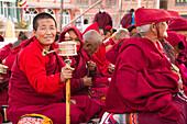 Tibetan Buddhist nun and prayer wheel, Boudhanath Stupa, Kathmandu, Nepal, Asia