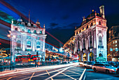 Traffic trails and festive Christmas lights at night, Piccadilly Circus, London, England, United Kingdom, Europe