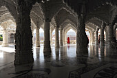 Woman in red sari in the marble pillared hall of Shri Swaminarayan temple, built after the 2001 earthquake, Bhuj, Gujarat, India, Asia