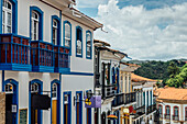 Colorful colonial buildings and narrow cobblestone streets of Ouro Preto, UNESCO World Heritage Site, Brazil, South America