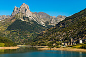 Lanuza lake and village and Pena Foratata peak in the scenic upper Tena Valley, Sallent de Gallego, Pyrenees, Huesca Province, Spain, Europe