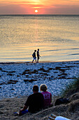People enjoy sunset at the lighthouse Gellen, Hiddensee, Ruegen, Baltic Sea coast, Mecklenburg-Vorpommern, Germany