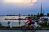 Boy with bike and fishing in Waase village on Ummanz, Ruegen, Baltic Sea coast, Mecklenburg-Vorpommern, Germany