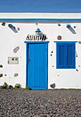 Blue front door in the fishing village Pozo Negro, Fuerteventura, Canary Islands, Islas Canarias, Atlantic Ocean, Spain, Europe