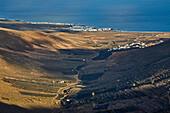 View from the viewpoint Mirador de Haria at the village of Arrieta, Lanzarote, Canary Islands, Islas Canarias, Spain, Europe