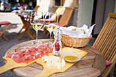Table with local wine and delicatessen like cheese and cured ham on terrace in Radovljica, Triglav, Slovenia