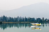 Float plane moored on Green Lake, Whistler, British Columbia, Canada