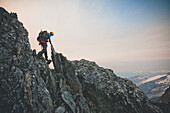 Side view of person mountaineering on Ashlu Mountain in Coast Mountain Range of British Columbia, Canada