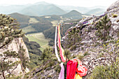Silks used by aerial silk performers hanging from highline between cliffs, Lower Austria, Austria