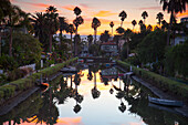 One of famous canals at sunset, Venice Beach, Los Angeles, California, USA