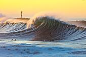 Wave surf at sunset at Wedge, Newport Beach, California, USA