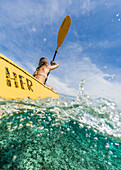 Woman kayaking in tropical waters, Tambon Ko Tarutao, Chnag Wat Krabi, Thailand