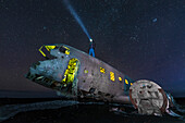 starry sky at the planewreck of a C117 that crash landed in the Sólheimasandur, southcoast, Iceland