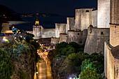 The illuminated city walls of Dubrovnik at night, UNESCO World Heritage Site, Dubrovnik, Croatia, Europe