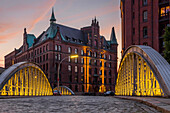 View from the Neuerwegsbrucke to the Sandtorkai-Hof building at the Speicherstadt (Warehouse Complex) at sunset, Hamburg, Germany, Europe