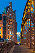 Typical building of the Speicherstadt (Warehouse Complex) and Kornhausbrucke (Kornhaus Bridge) at dusk, Hamburg, Germany, Europe