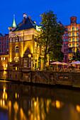 Illuminated Wasserschlosschen building in the historical Speicherstadt (Warehouse Complex) at dusk, Hamburg, Germany, Europe