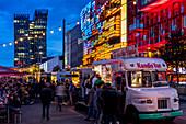 Food truck festival at the Spielbudenplatz near Reeperbahn at dusk, Hamburg, Germany, Europe