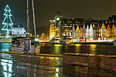 Vagen Harbour at night with the Bryggen waterfront, UNESCO World Heritage Site, and the Bergenhus fortress, Bergen, Hordaland, Norway, Scandinavia, Europe
