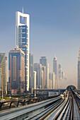 View of the Dubai metro rapid transit rail network and skyscrapers, Dubai, United Arab Emirates, Middle East