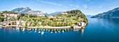 Panoramic aerial view of sailboats in Lake Como around the village of Pescallo, Bellagio, Province of Como, Lombardy, Italian Lakes, Italy, Europe (Drone)