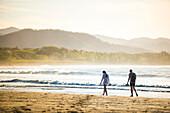 Couple on Playa Buena Vista Beach at sunrise, Guanacaste Province, Costa Rica, Central America