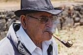 man with canarian pipe, livestock fair in San Antonio del Monte, Garafia region, UNESCO Biosphere Reserve, La Palma, Canary Islands, Spain, Europe