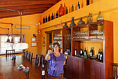 woman wiith a glass of wine, tasting room, wine, Bodega El Nispero, El Castillo, Garafia region, UNESCO Biosphere Reserve, La Palma, Canary Islands, Spain, Europe