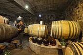 wine barrels, woman takes a wine sample, Bodega Matias i Torres, Fuencaliente, UNESCO Biosphere Reserve, La Palma, Canary Islands, Spain, Europe