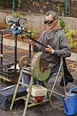 knife sharpener, Mercadillo, weekly market, market hall, in the El Fayal pinewood near Puntagorda, Puntagorda, UNESCO Biosphere Reserve, La Palma, Canary Islands, Spain, Europe