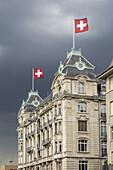 Utoschloss, historic city palais, neo baroc, swiss flag, Utoquai , Seefeld, Zurich, switzerland