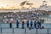 Viewpoint near Dom Luis I  bridge, group of tourists with trolleys, Porto, Portugal Porto, Portugal