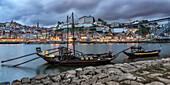 traditional Rabelo boats, Douro river, cityscape, panorama, twilight,  Porto, Portugal