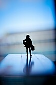 Silhouette of a woman with hand luggage and a package