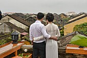 Love on the rooftop, historic old district, Hoi An, Vietnam.
